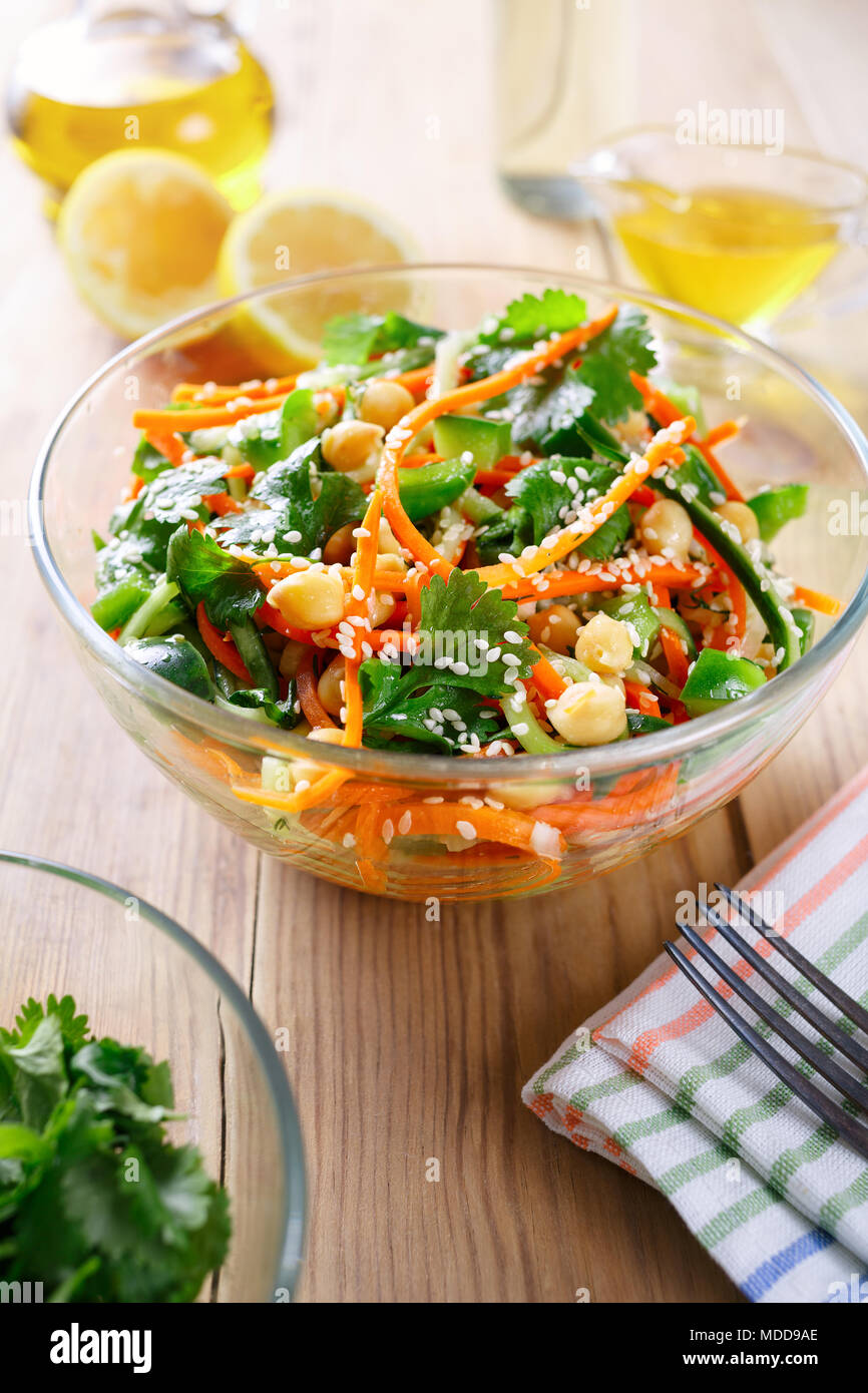 Thai salad from noodles raw carrots and cucumber with