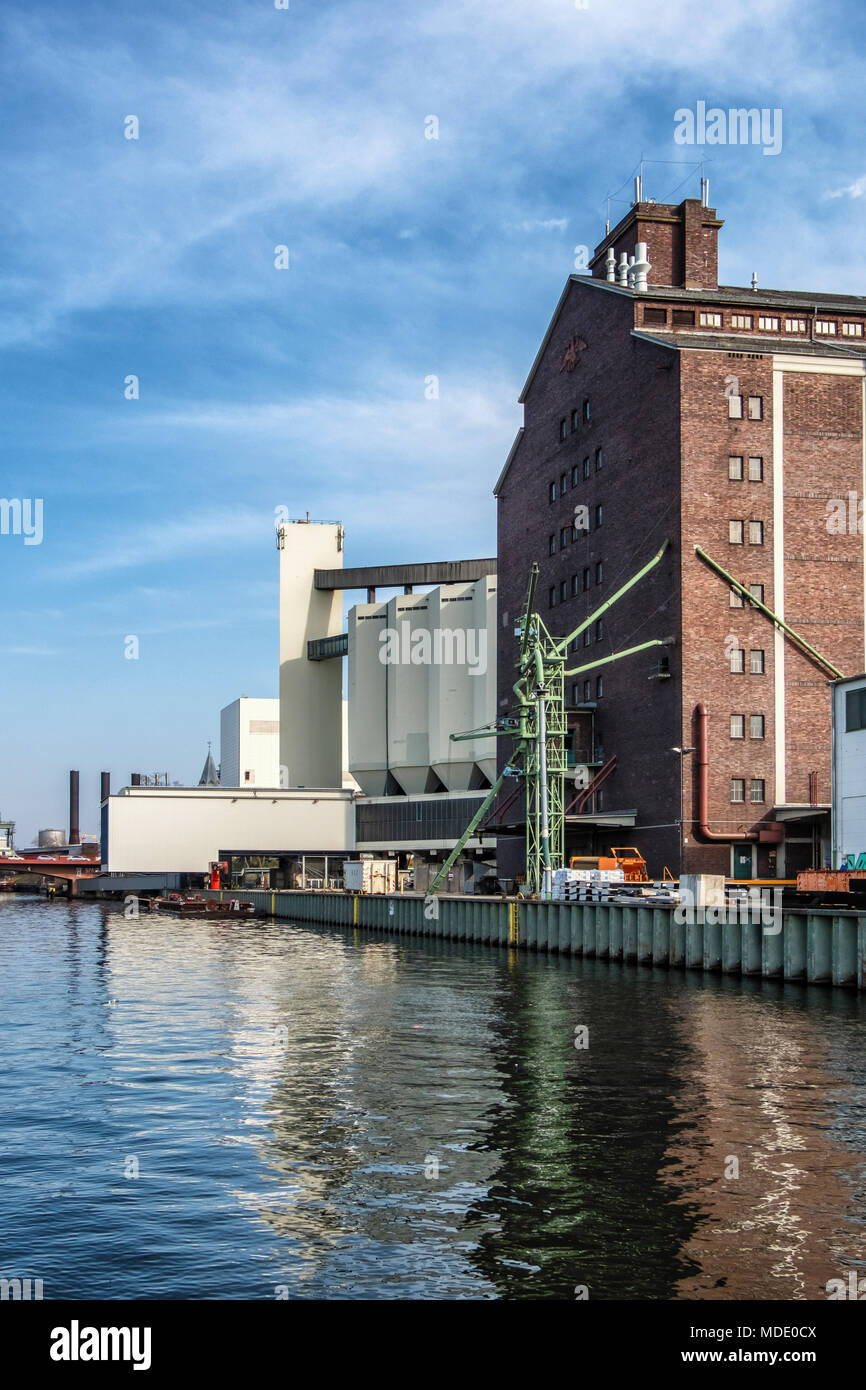 Berlin-Moabit,Westhafen,West Harbor,. Behala historic brick warehouse building and silo next to canal Stock Photo