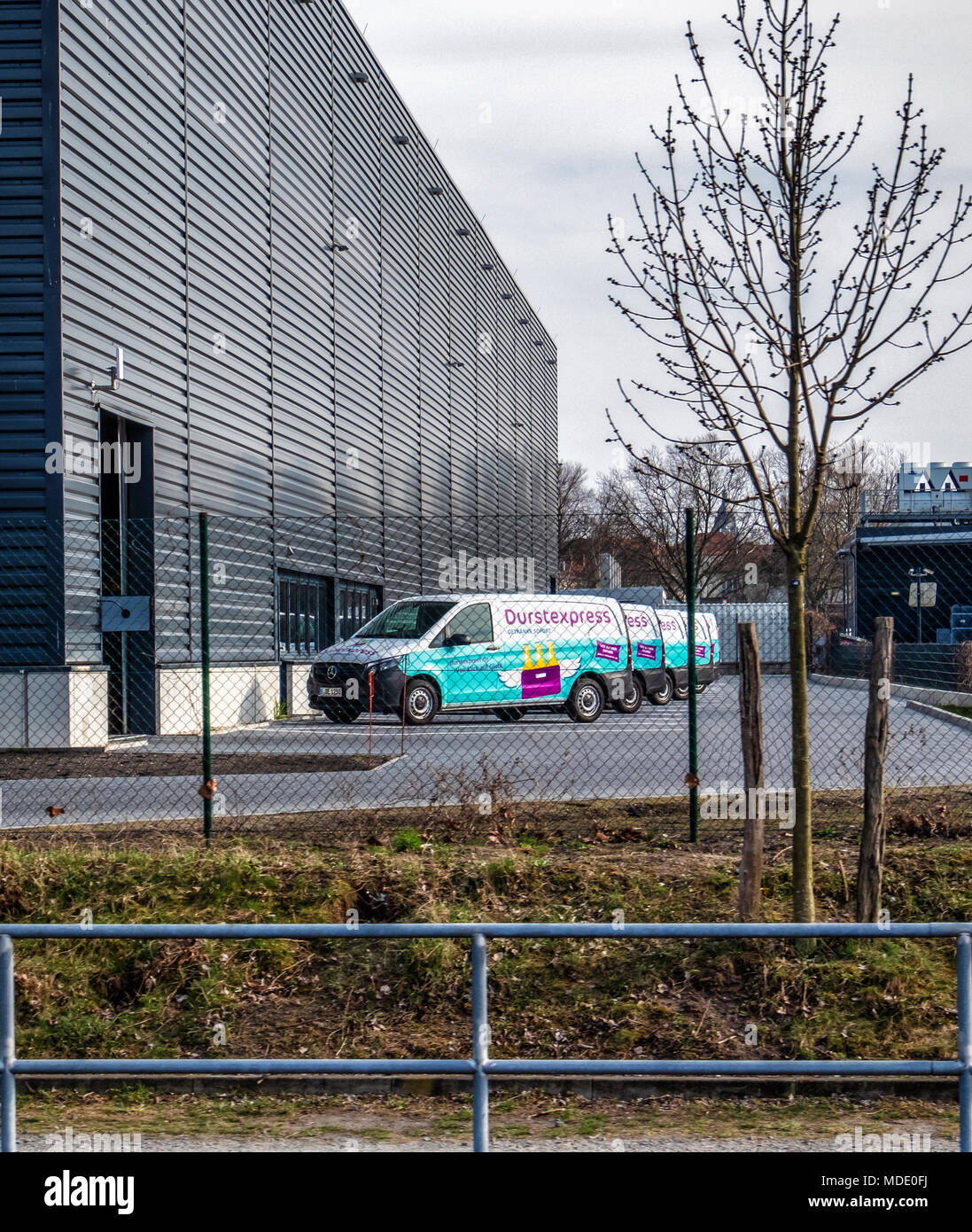 Berlin Charlottenburg-Wilmersdorf. Durstexpress delivery vans parked outside warehouse next to Westhafen canal. On-line drinks ordering business Stock Photo