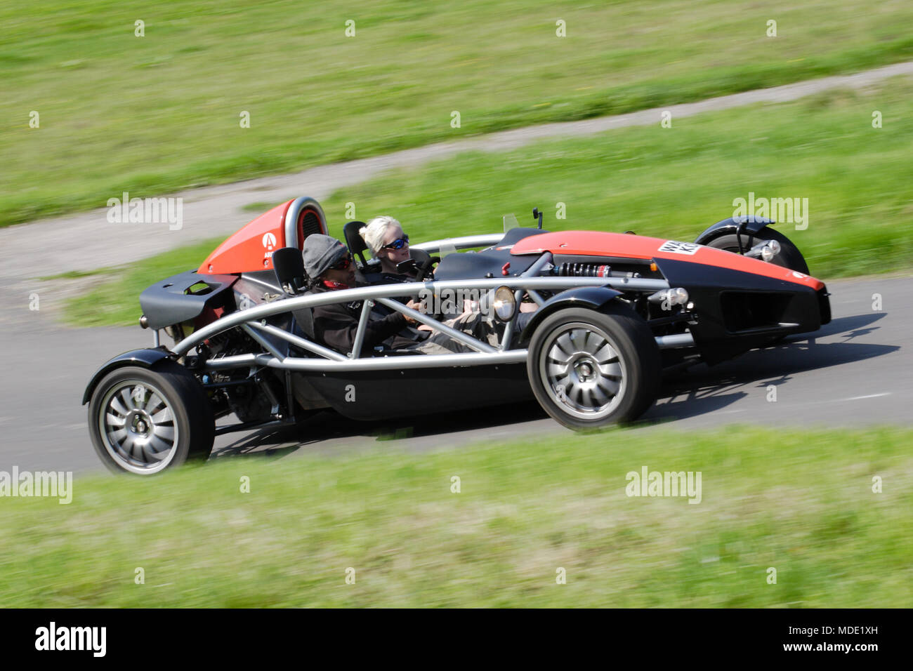 Ariel Atom lightweight sports car or track car driving fast on the UK public roads. Ariel Atoms have a visible car exoskeleton. - Stock Image