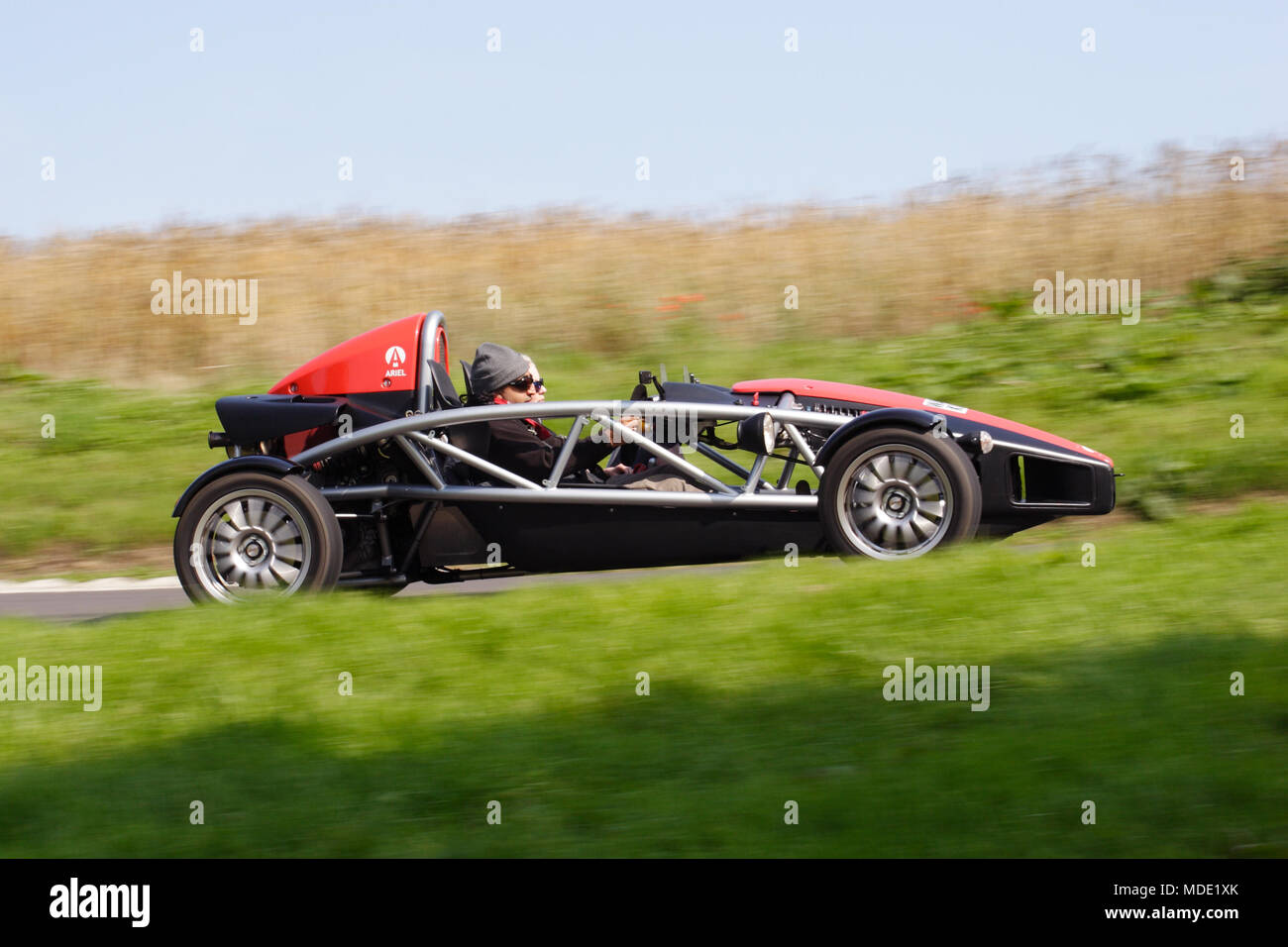 Profile (side view) Ariel Atom 2 seat two-seater lightweight sports car track car driving fast. Transparent see-through visible car exoskeleton. - Stock Image
