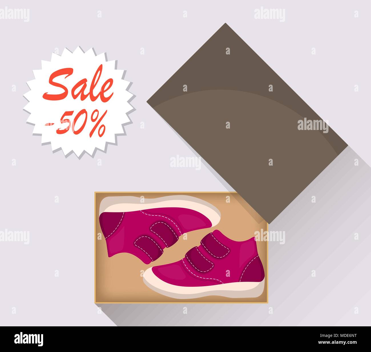 Little cute baby shoes in box, side
