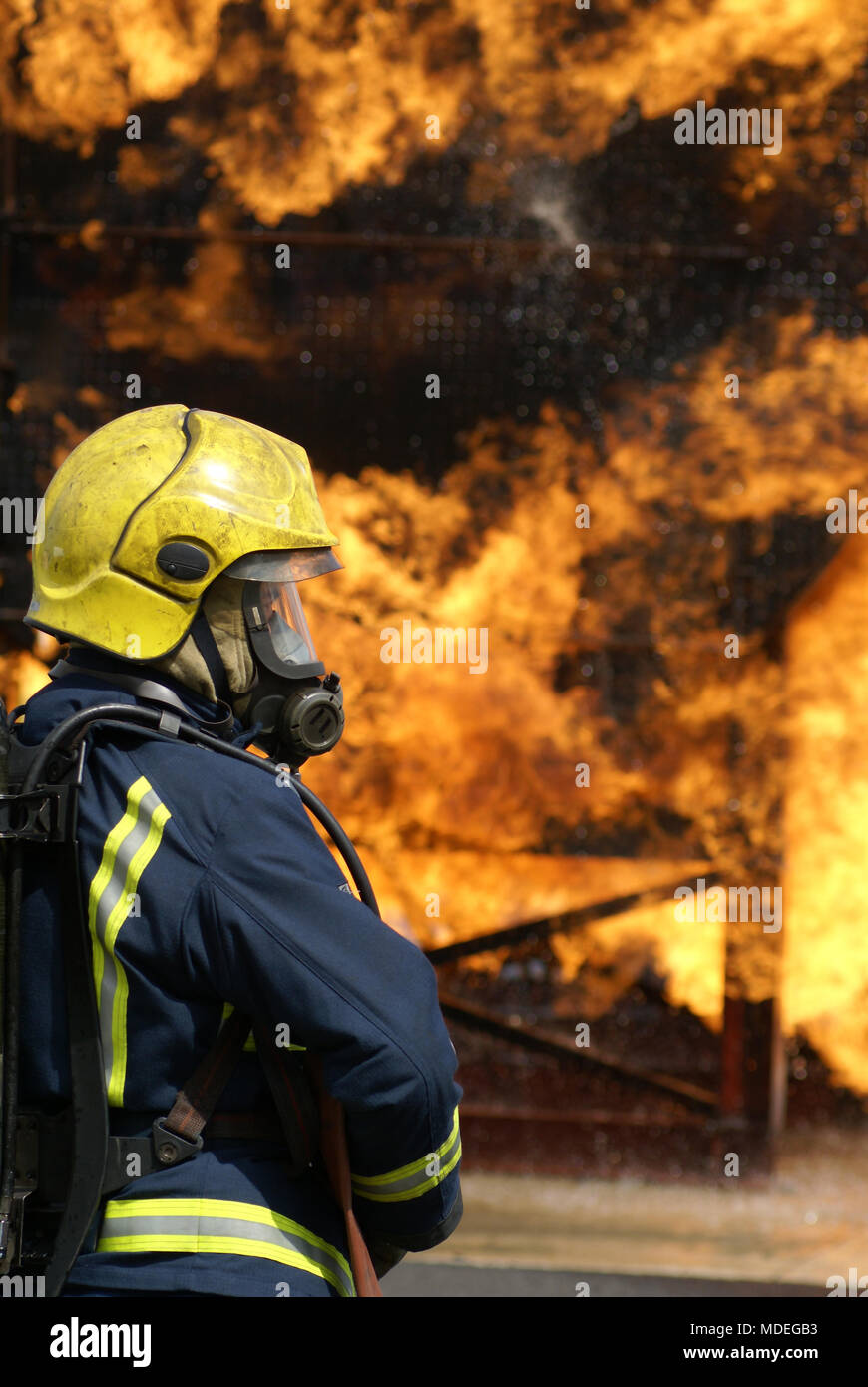 firefighting, aircraft crash, fire and flames - Stock Image