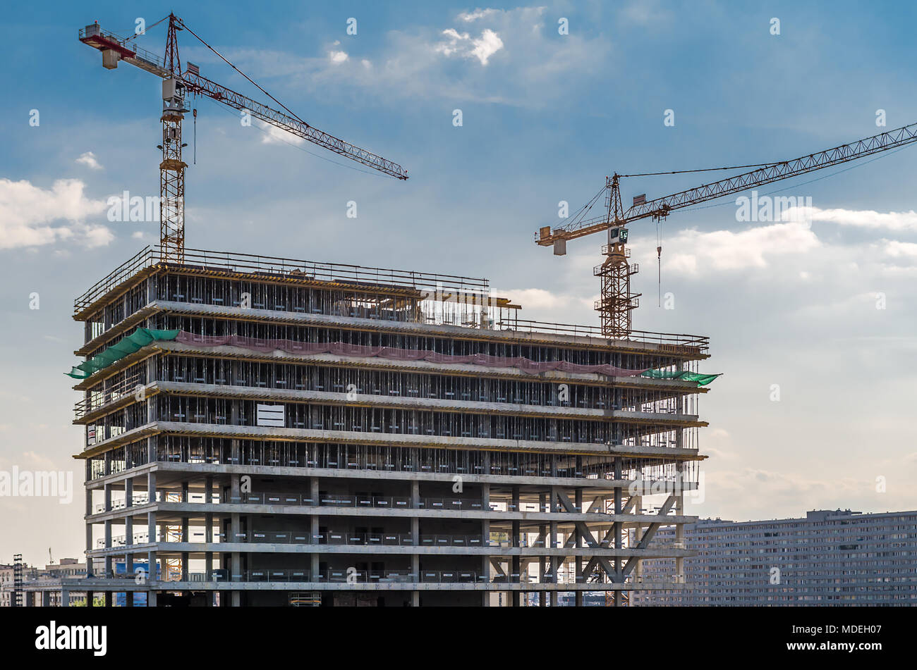 View of new construction of high-rise against blue sky in KAtowice, Silesia, Poland. - Stock Image