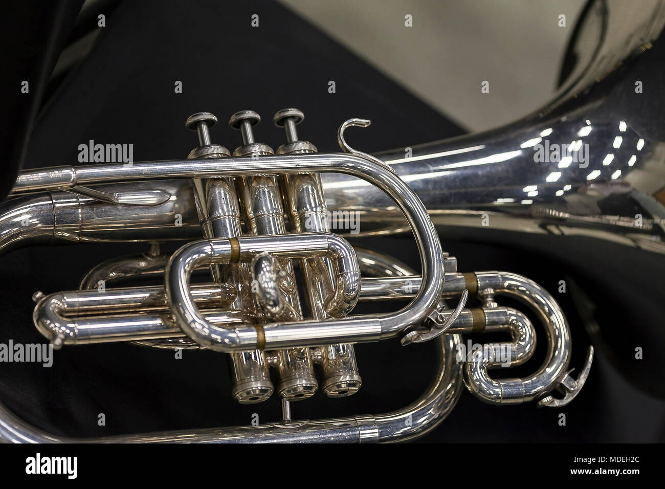 the valves of a marching band mellophone - Stock Image