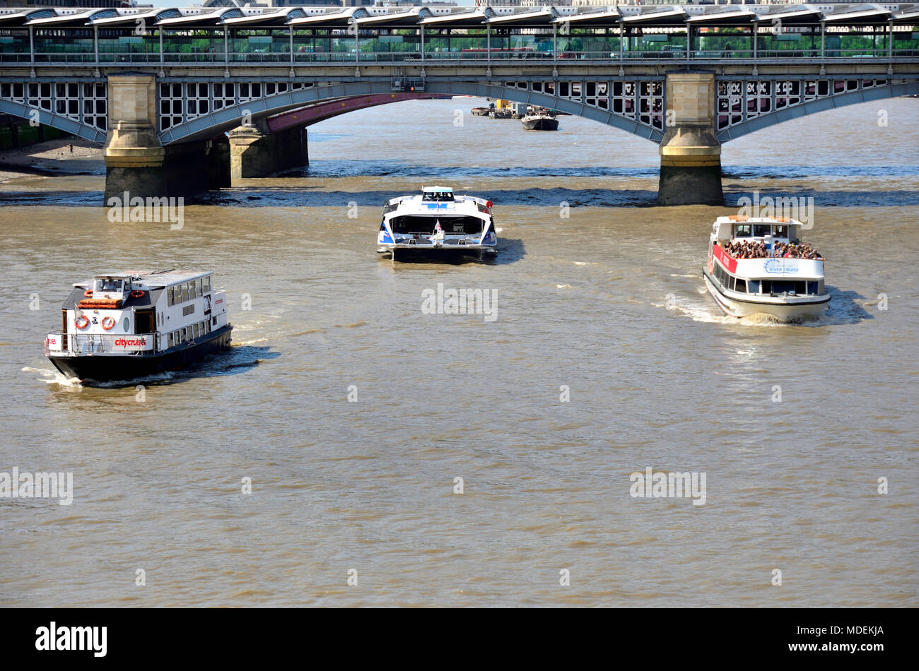 London, England, UK. Tourist cruise boats on the River Thames - Stock Image