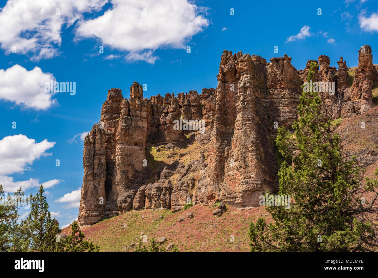 Majestic rock formations thrust from the ground at the John Day National Monument Clarno Unit. 18 miles west of Fossil Oregon. Volconic lahars formed  - Stock Image