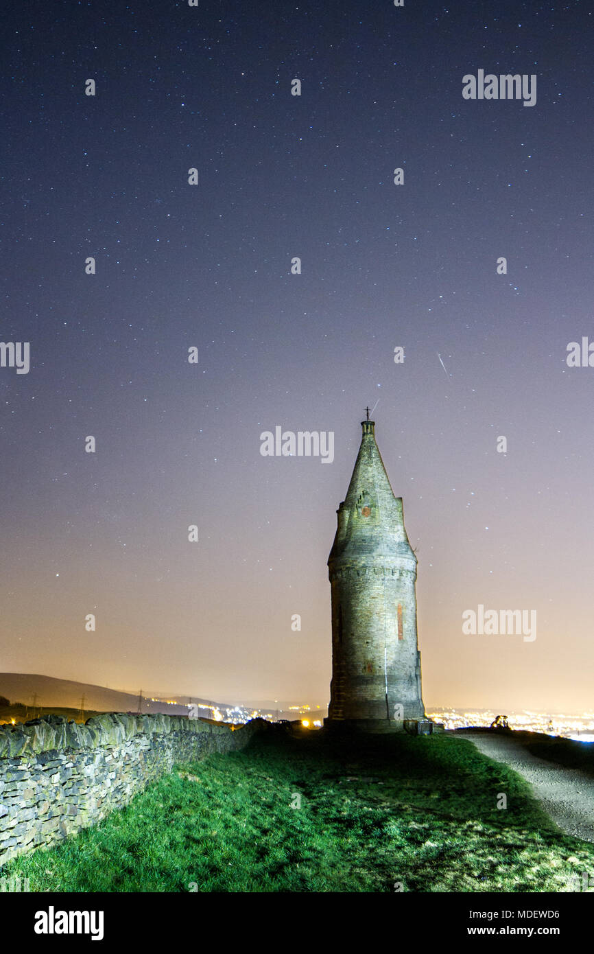 Night shot of Hartshead Pike capturing the night sky and the stars above the Victorian Beacon in Mossley, Tameside, UK. - Stock Image