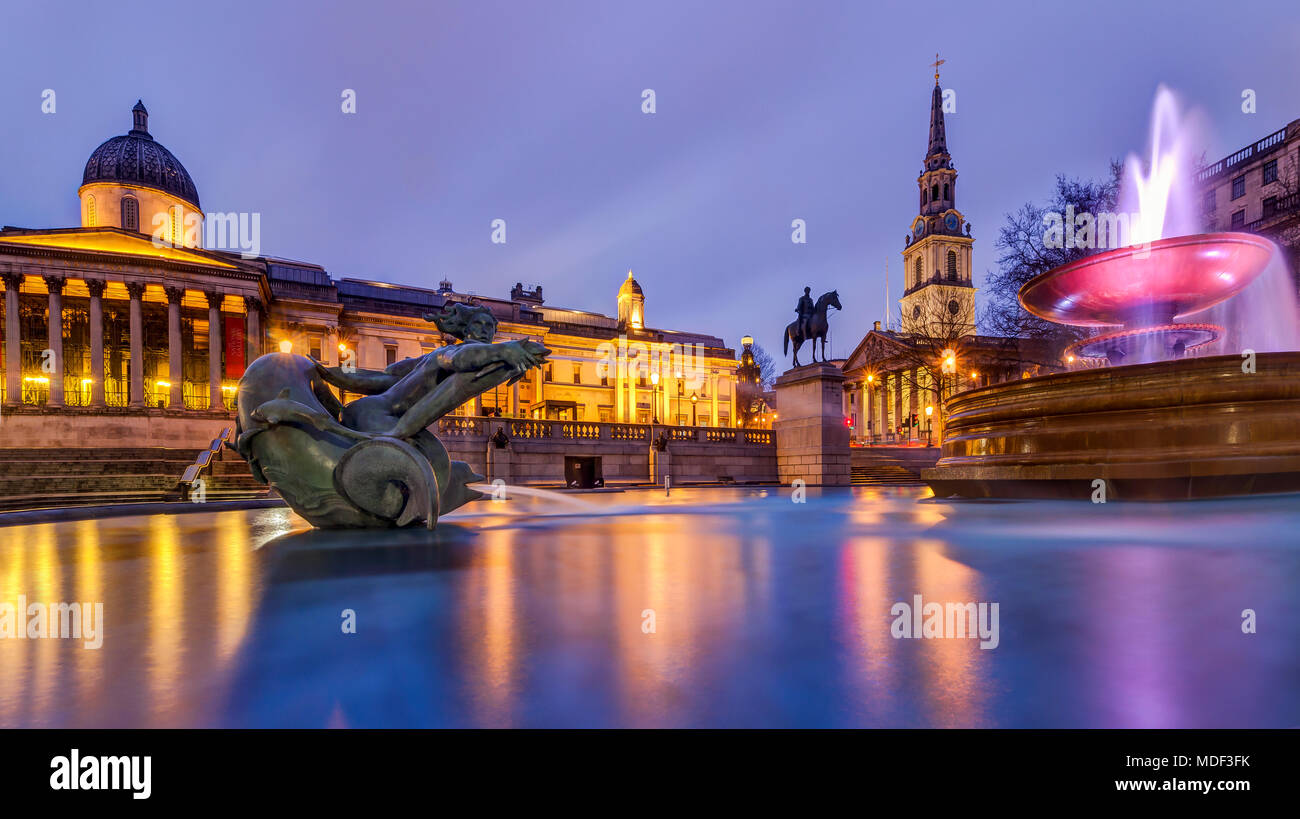 An evening view over the fountains in Trafalgar Square, London, England - Stock Image
