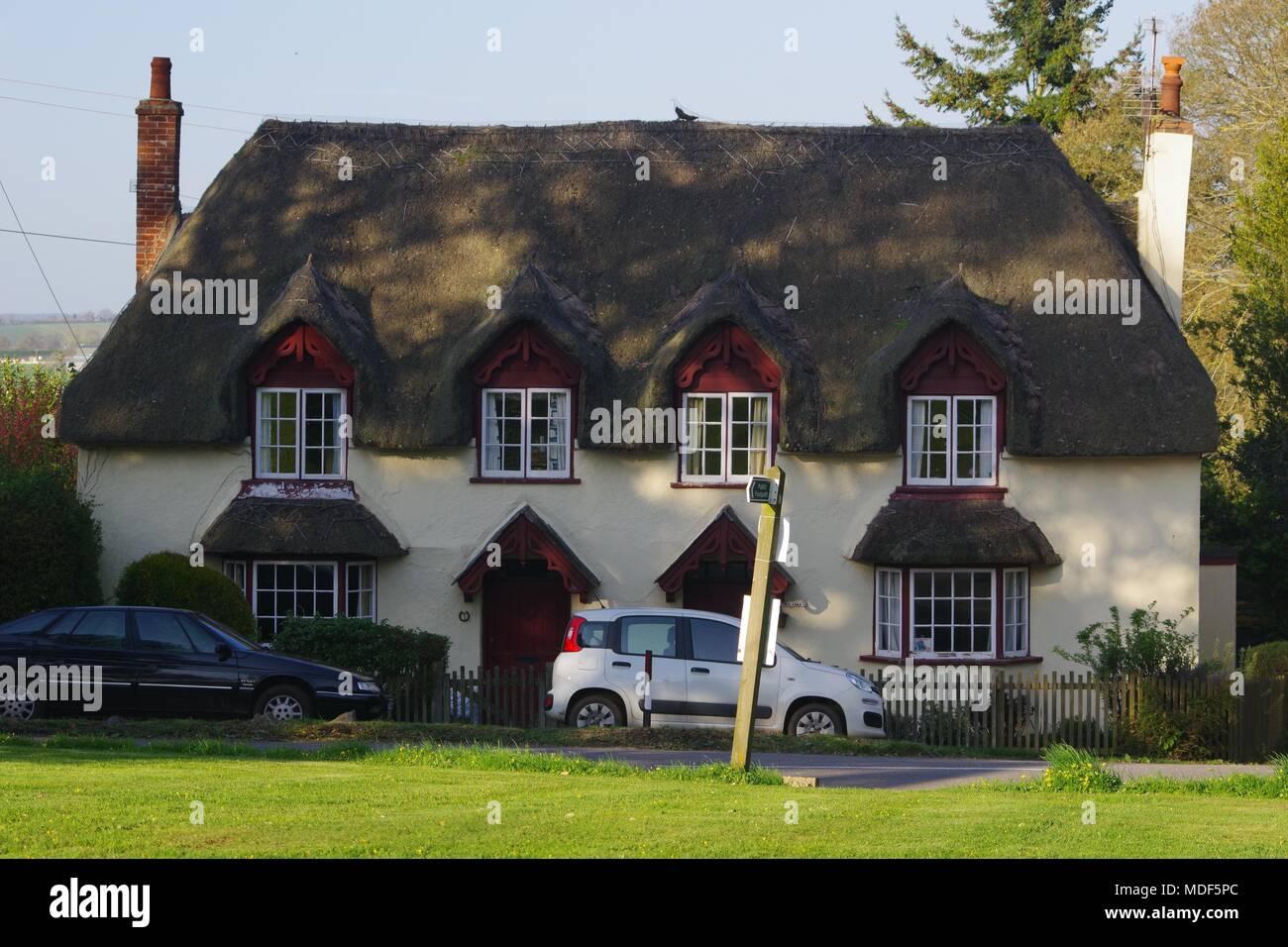 Quaint Rural Thatched Cottage. Church Road, Powderham, Exeter, Devon, UK. April, 2018. - Stock Image