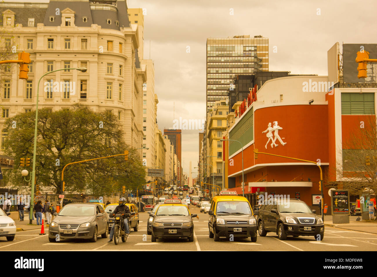 BUENOS AIRES, ARGENTINA - SEPTEMBER 20: Cars and taxis on Corrientes Street, the longest street in the world, with the famous Luna Park concert hall o - Stock Image