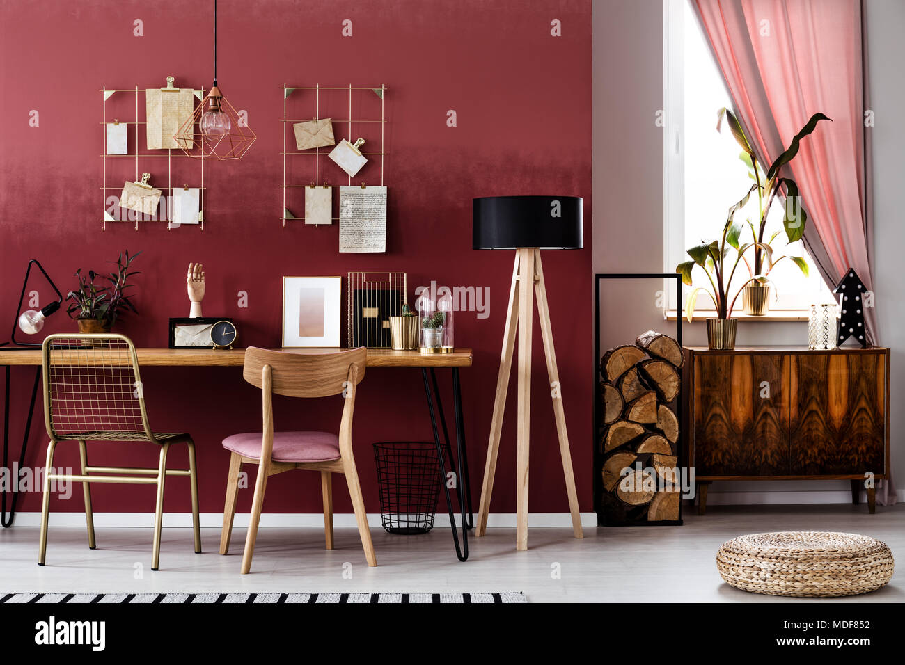 Wooden Lamp Next To A Desk And Chair In Cherry Home Office Interior With  Pouf