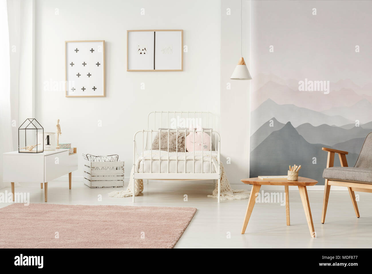 White, metal bed standing in bright kids room interior with simple ...