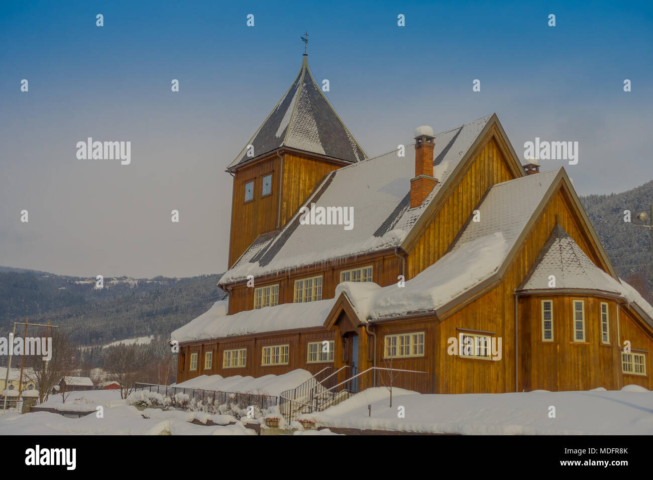 Outdoor view of the Stave Church partial covered with snow during a heavy winter season in Gol - Stock Image