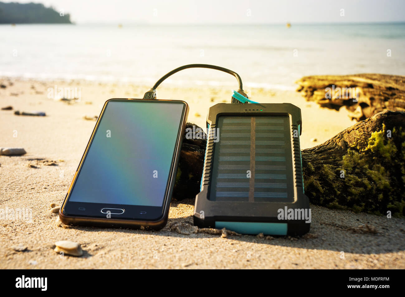 Battery Solar Energy Device On A Background Of The Sandy Beach An Picture Charging Uninhabited Island Charge Smart Phone From