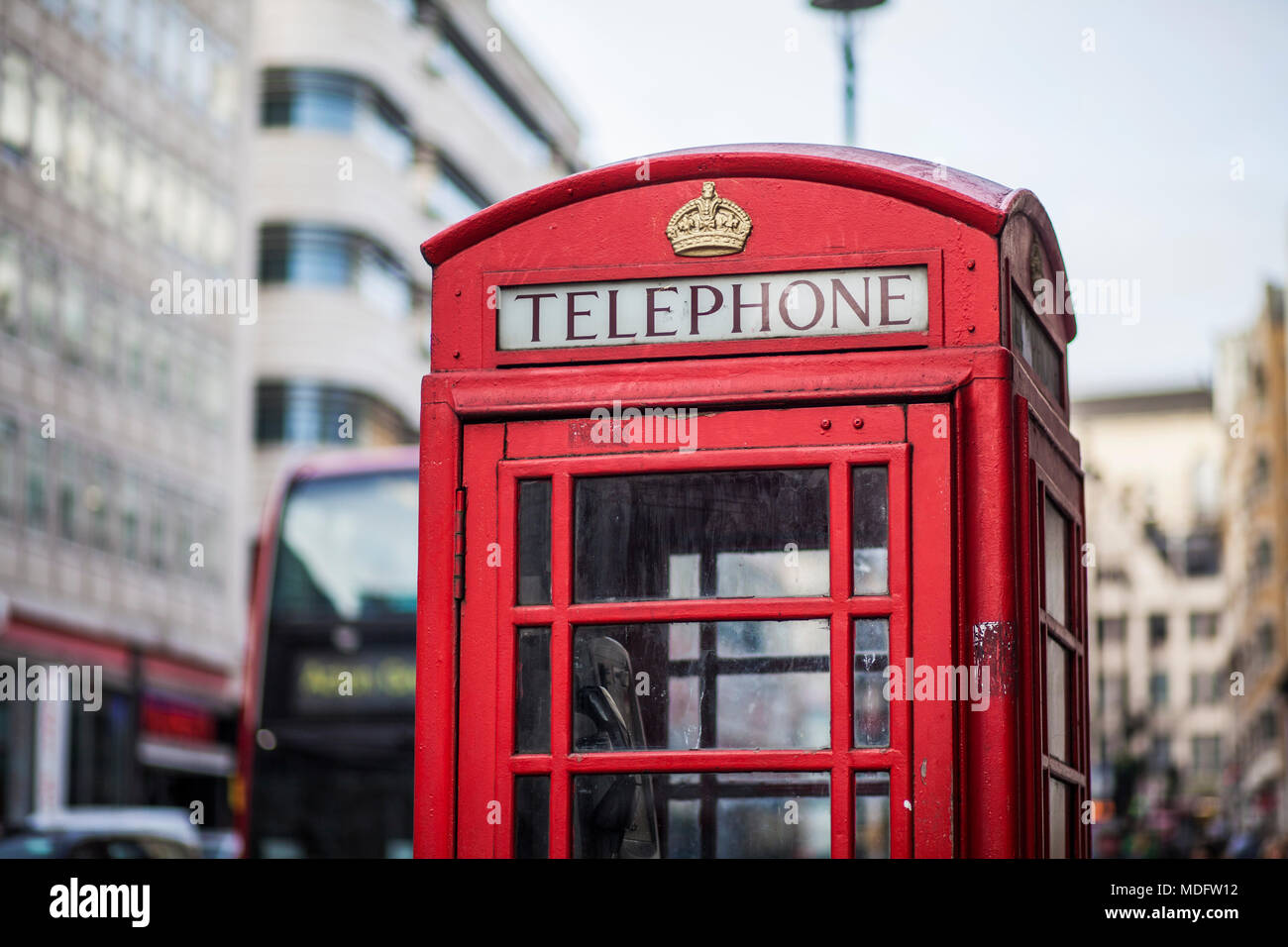 Traditional Red telephone box on a street in London, UK - Stock Image