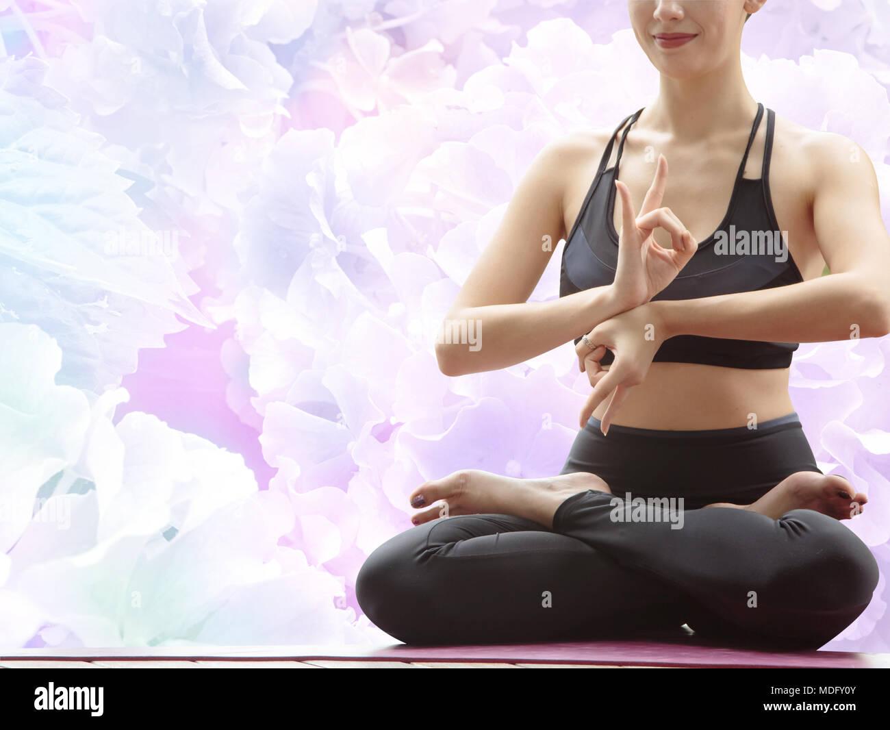 Yoga Beautiful Woman Meditating In Lotus Pose On Blur Hydrangea