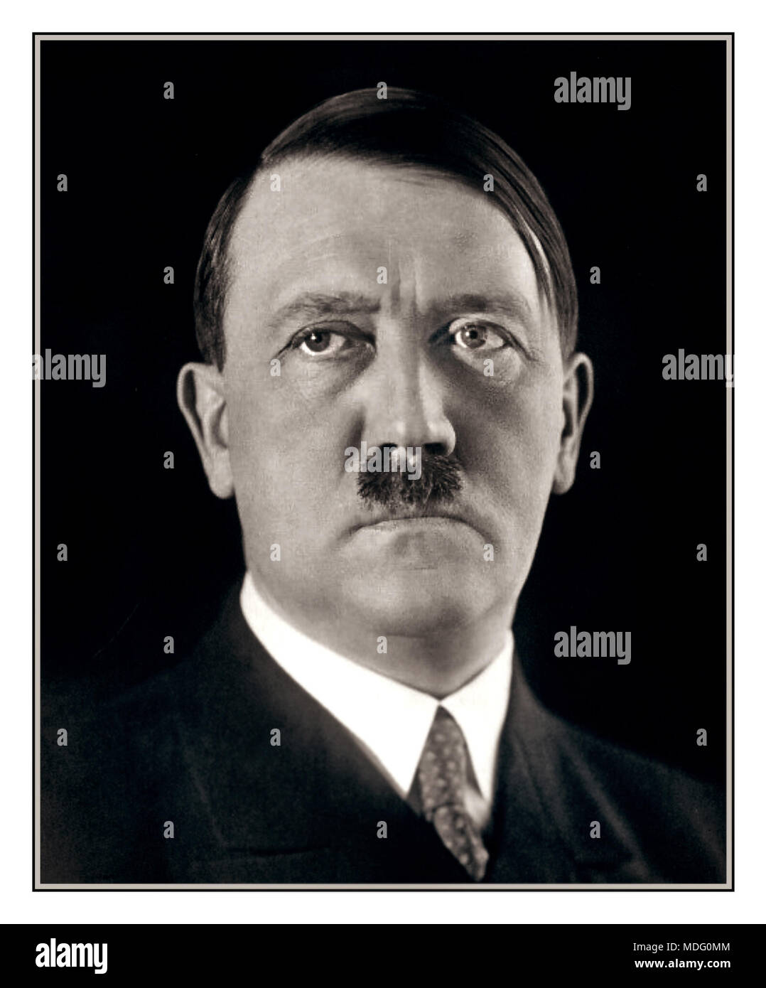 1920's formal portrait Adolf Hitler striking a pose for his photographer Heinrich Hoffmann. 1925. After seeing the photographs, apparently Hitler ordered Hoffmann to destroy the negatives, but he disobeyed. - Stock Image