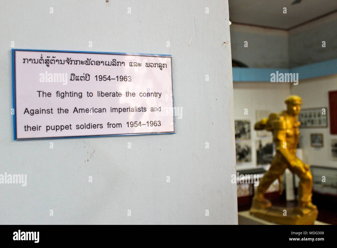 A sign depicting the fight against the American imperialists on display at the Lao National Museum. Vientiane, Laos, 2015. - Stock Image