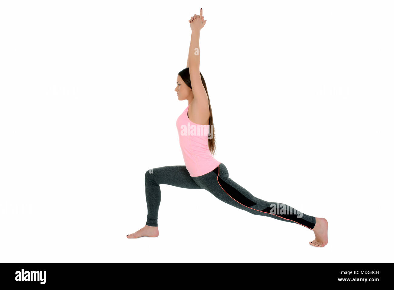 A Young White Girl Performs Yoga Asanas Warrior Pose On Sanskrit Virabradasana