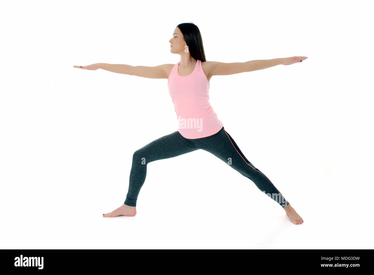 A Young White Girl Performs Yoga Asanas Warrior Pose On Sanskrit Virabradasana