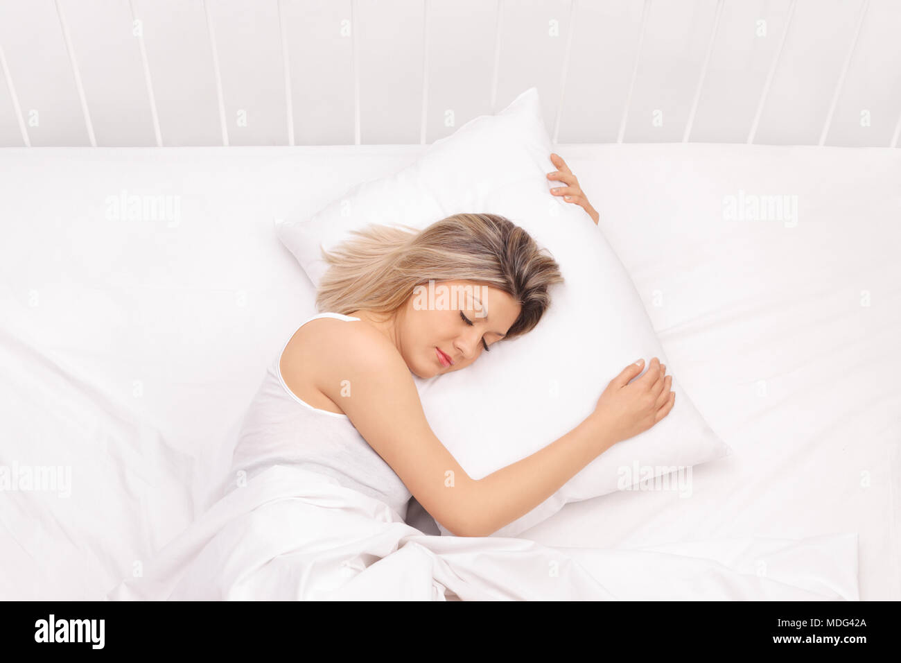 Woman sleeping in bed - Stock Image