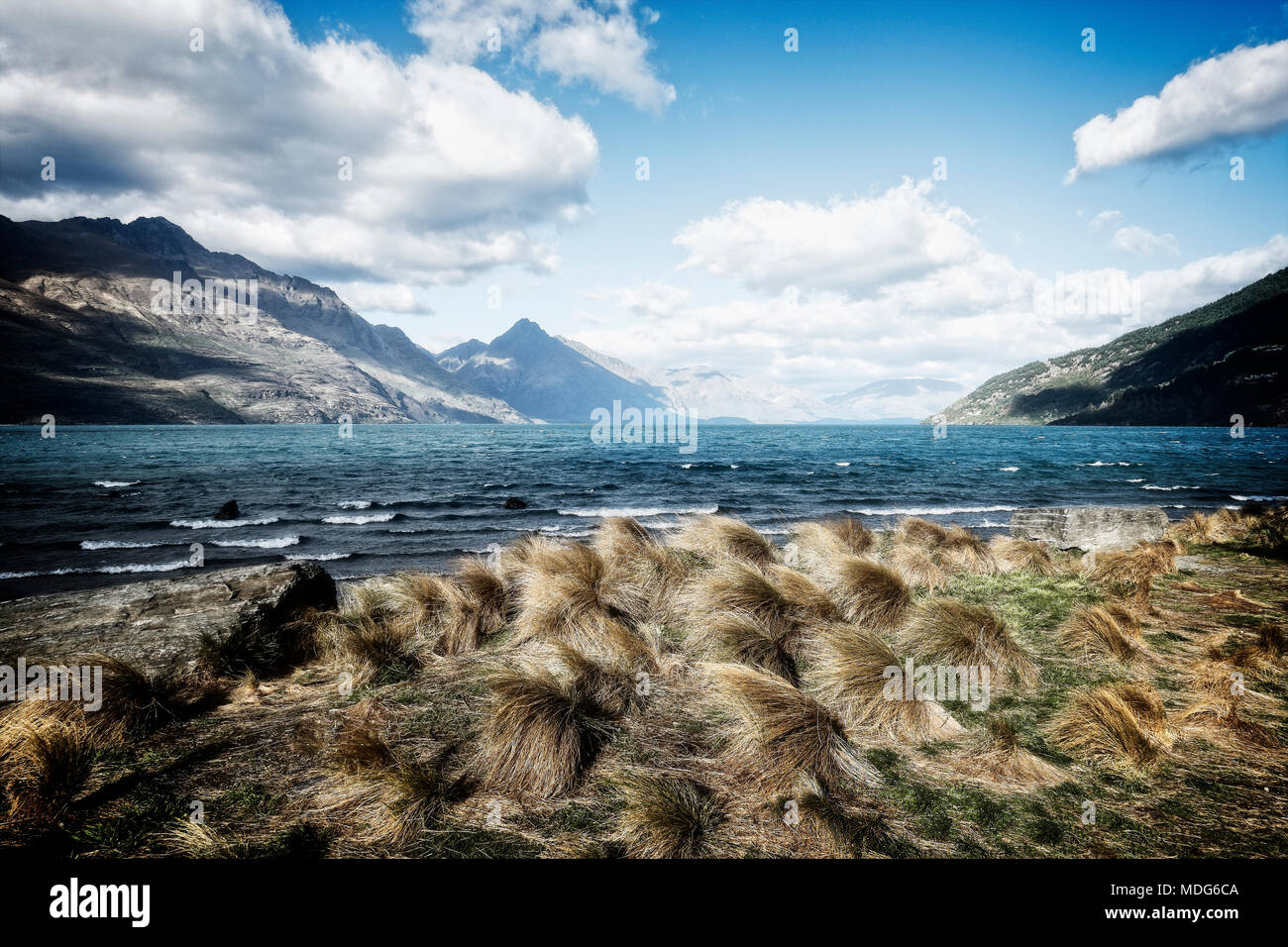 Wind sweeps across Lake Wakatipu near Queenstown creating whitecaps, South Island, New Zealand. - Stock Image