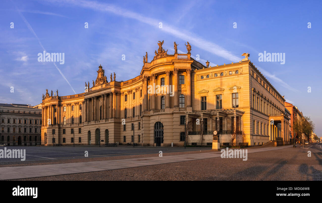 Faculty of Law of the Humboldt-Universität zu Berlin (HUB), formerly the Royal Library, bathed in the orange light of sunrise. - Stock Image