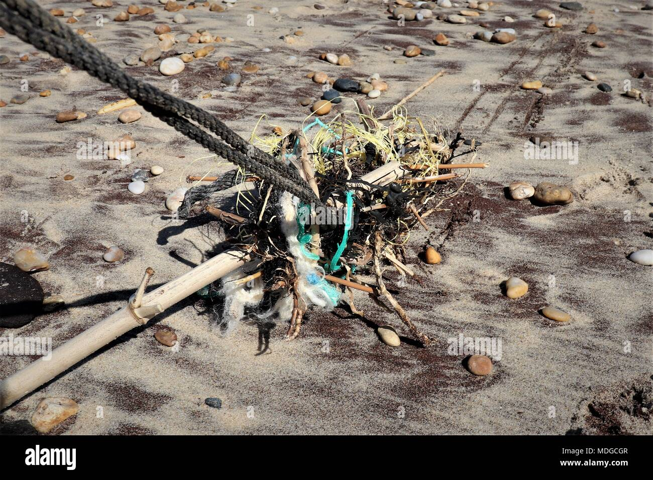 Flotsam and Jetsam on the HIgh Tide Line at Montalivet, Aquitaine, France, with Plastics and Micro Beads - Stock Image