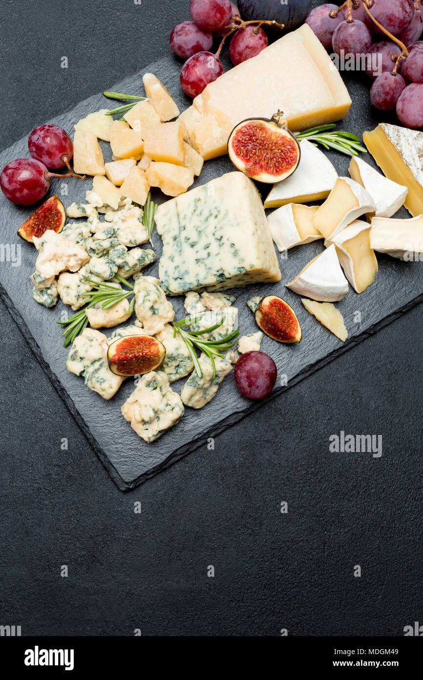 Slice of French Roquefort cheese with figs - Stock Image