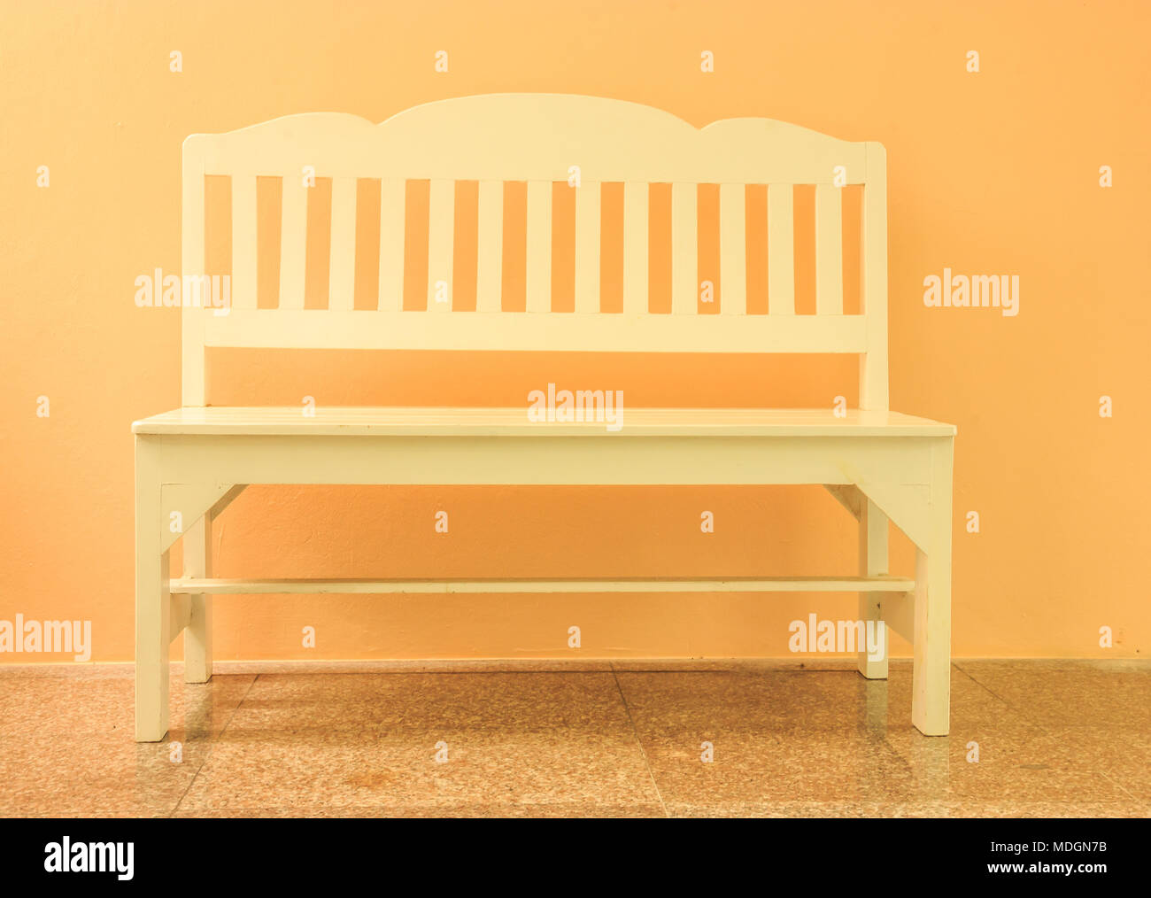 white wooden indoor bench on the cream color background Stock Photo ...