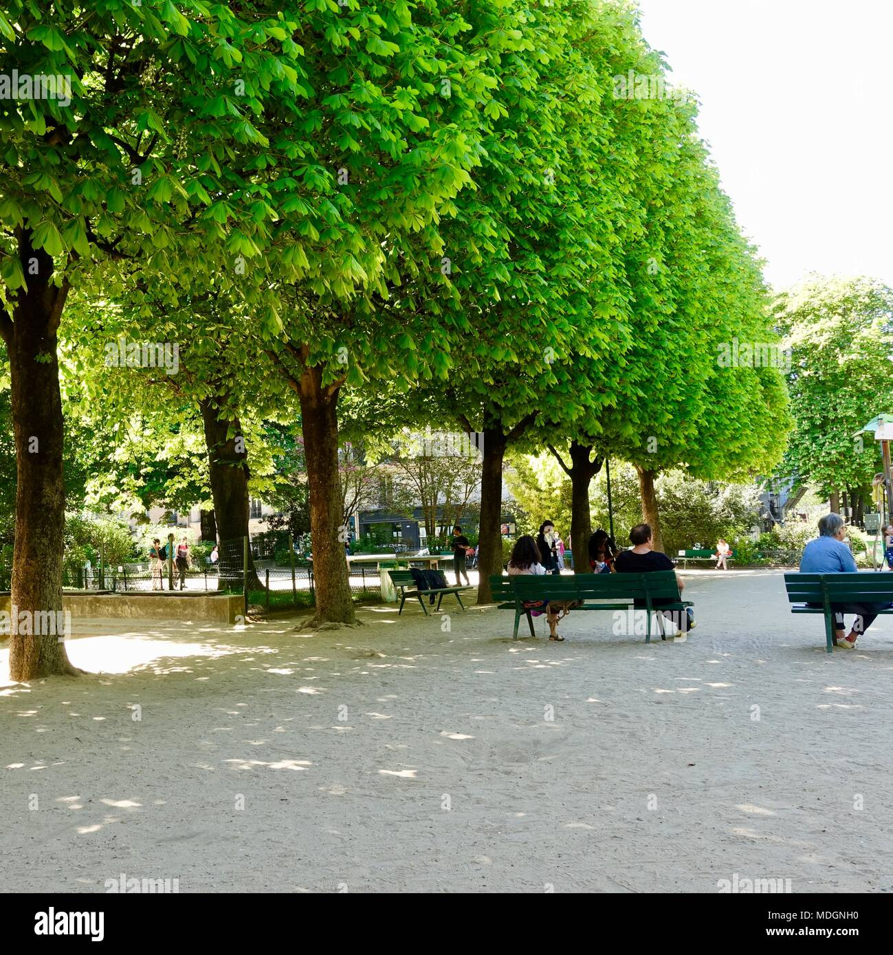 Families, people, relax in Square Maurice Gardette on a warm spring day. Paris, France. - Stock Image