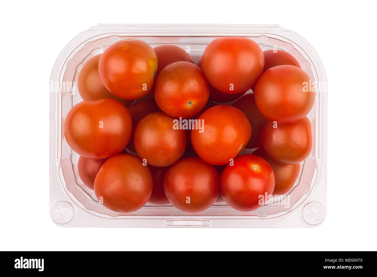 top view closeup detail of red cherry tomatoes in open plastic transparent packaging container isolated on white background - Stock Image