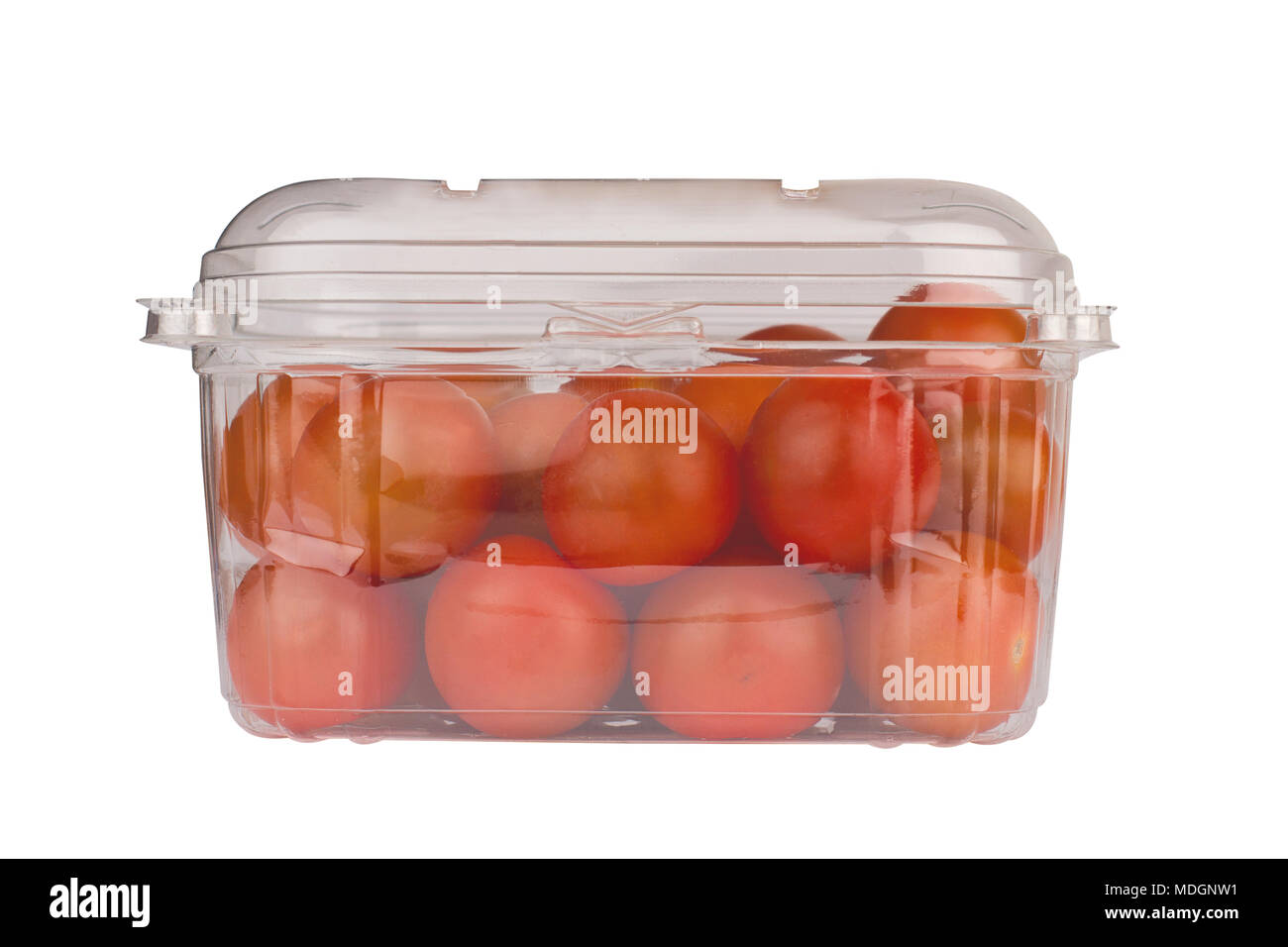 front view closeup detail of red cherry tomatoes in closed plastic transparent packaging container isolated on white background - Stock Image