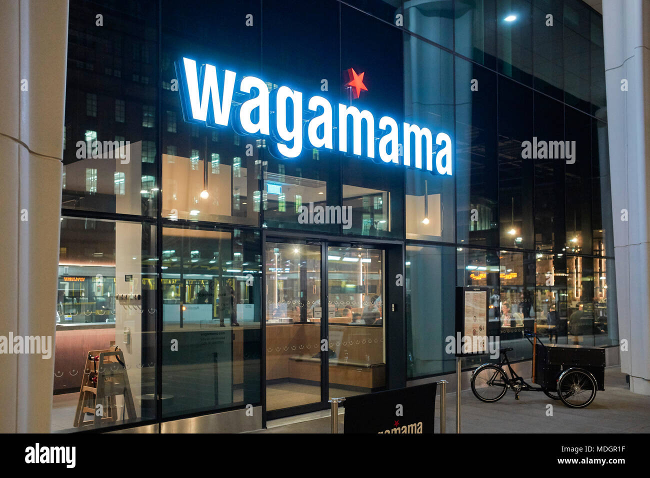 Wagamama restaurant at night in St Peter's Square, Manchester - Stock Image