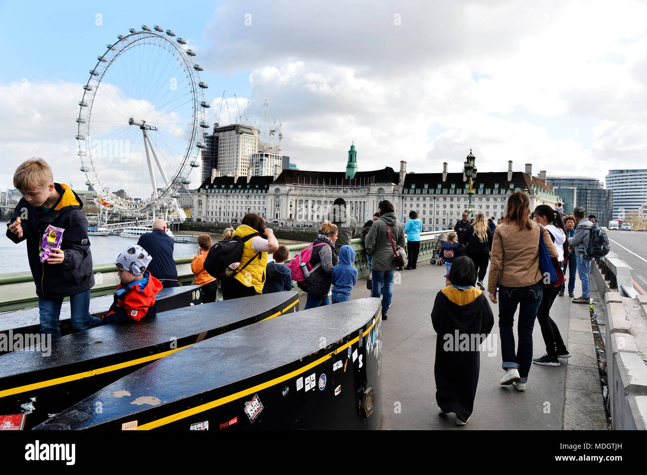 Security Bollards and London's Eye seen from Westminter Bridge - London - England - Stock Image