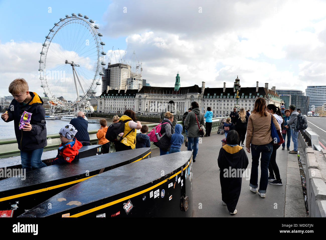 Security Bollards and London's Eye seen from Westminter Bridge - London - England Stock Photo