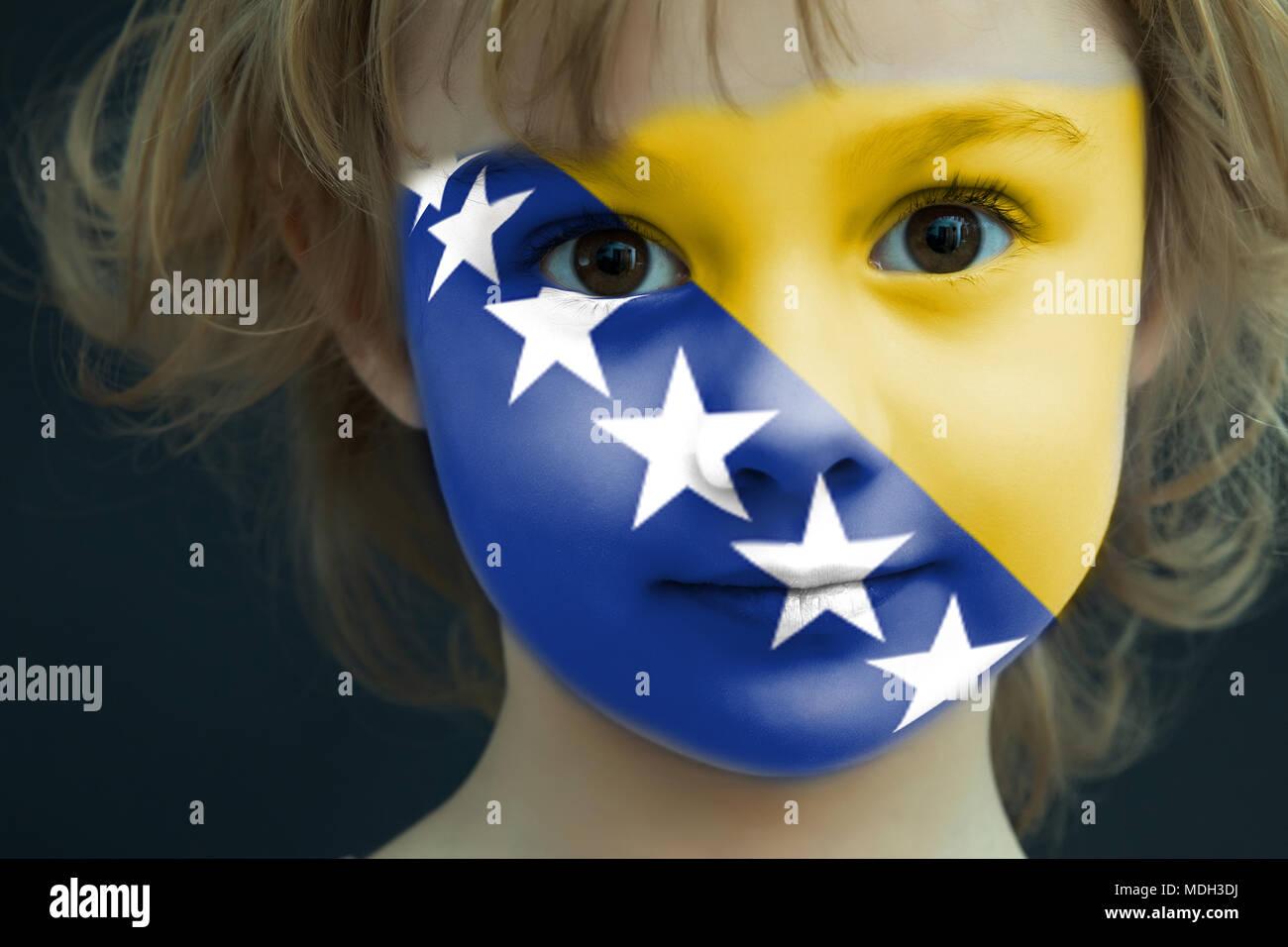 Child with a painted flag of Bosnia-Herzegovina - Stock Image