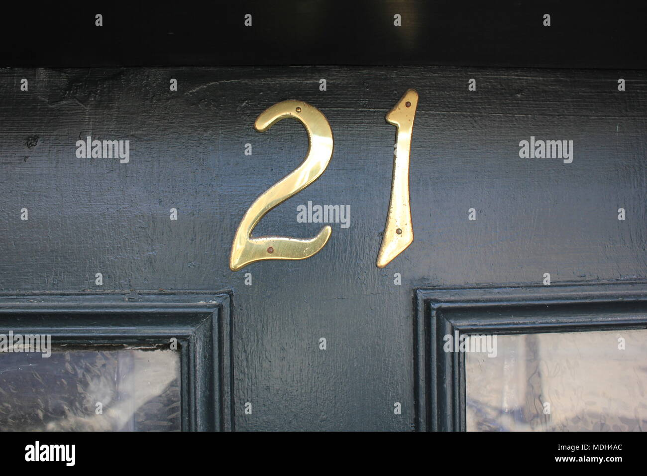 The number 21 signifying an address designation. - Stock Image