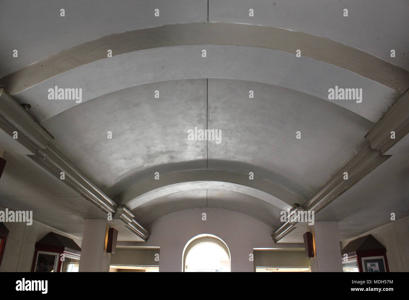 Architecturally decorative ceiling covering an outdoor passageway. - Stock Image