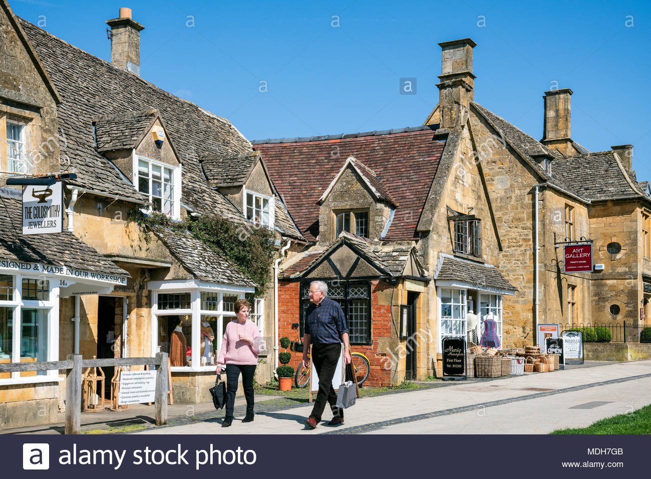 High Street, Broadway, Cotswolds on a sunny spring day with blue skies. - Stock Image