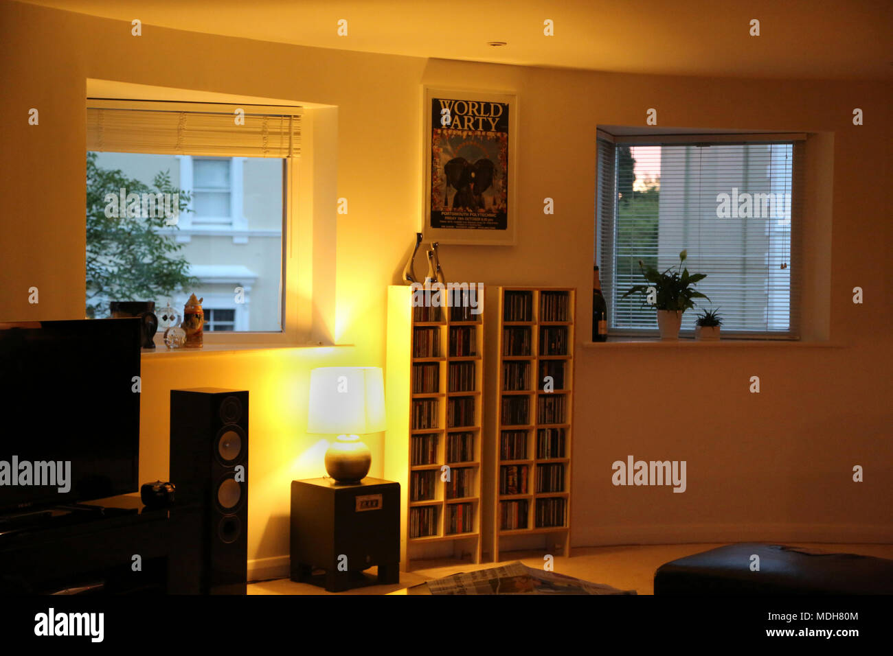 Open Plan Living Room With CD's On Shelves In the Evening Cheltenham Gloucestershire England - Stock Image
