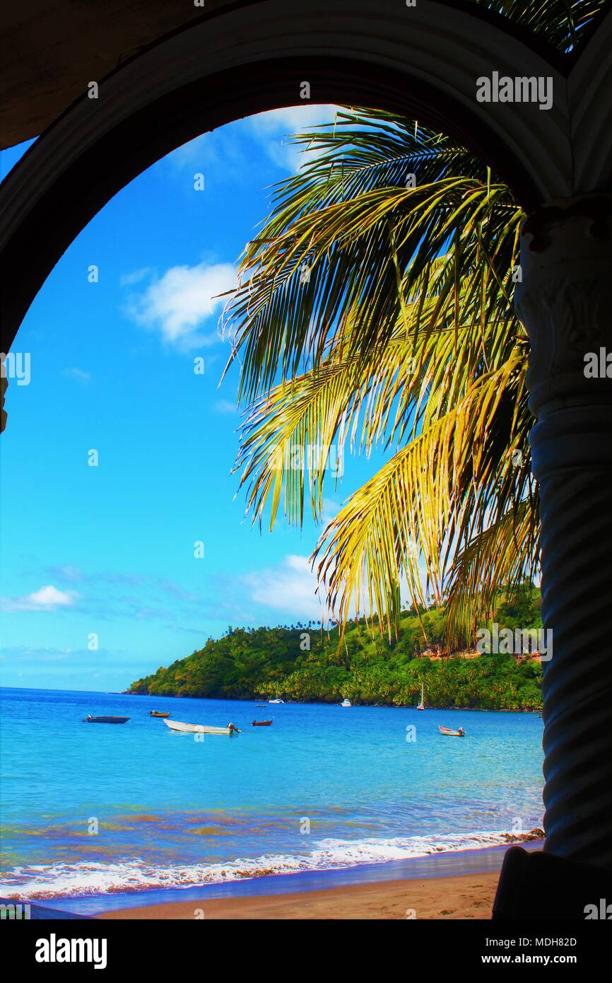 View through an arch of a secluded beach on the Caribbean island of