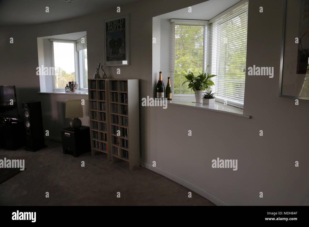 Open Plan Living Room With CD's On Shelves Cheltenham Gloucestershire England - Stock Image