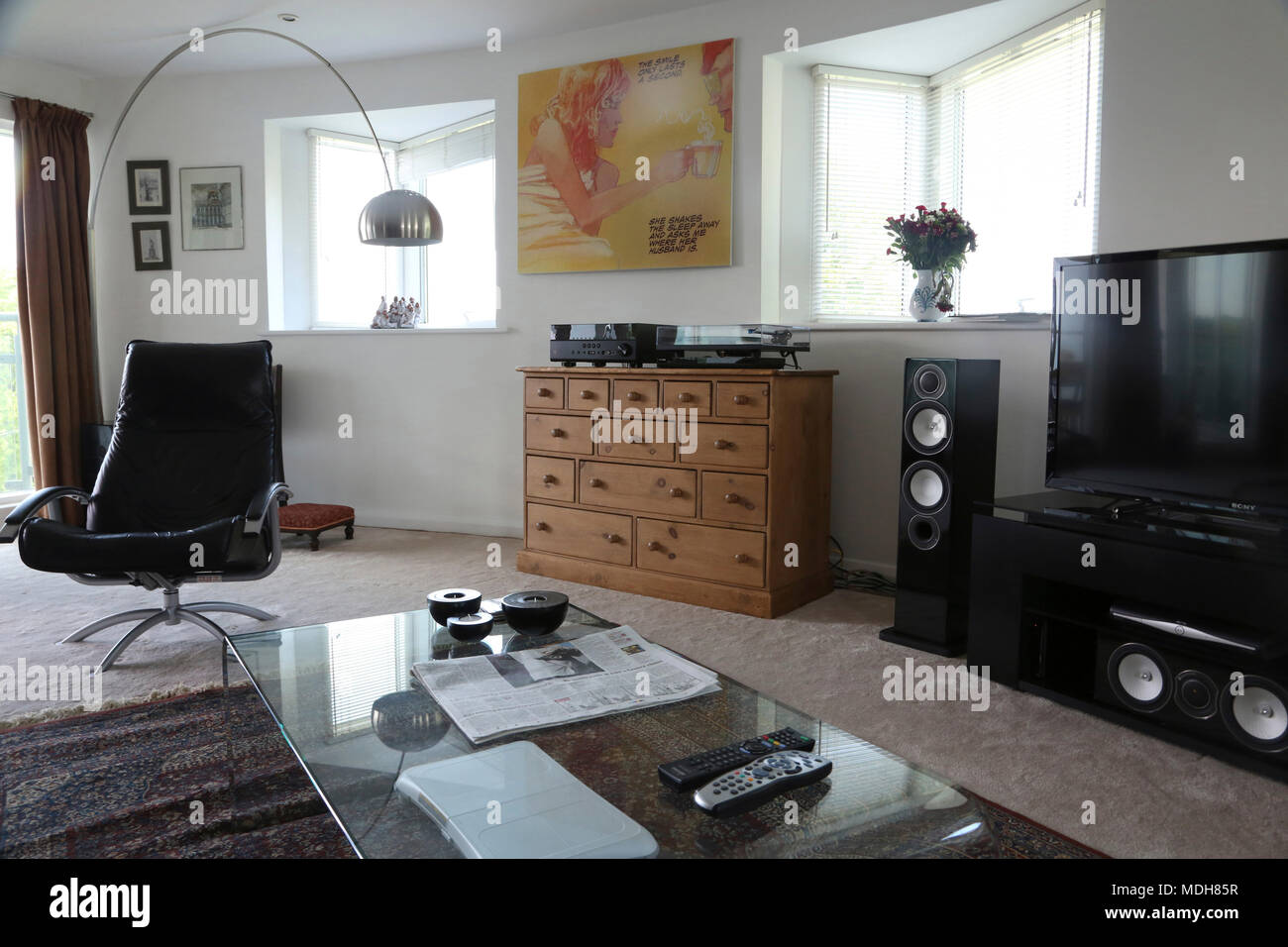 Open Plan Living Room With Modern Light And Leather Chair Cheltenham Gloucestershire England - Stock Image