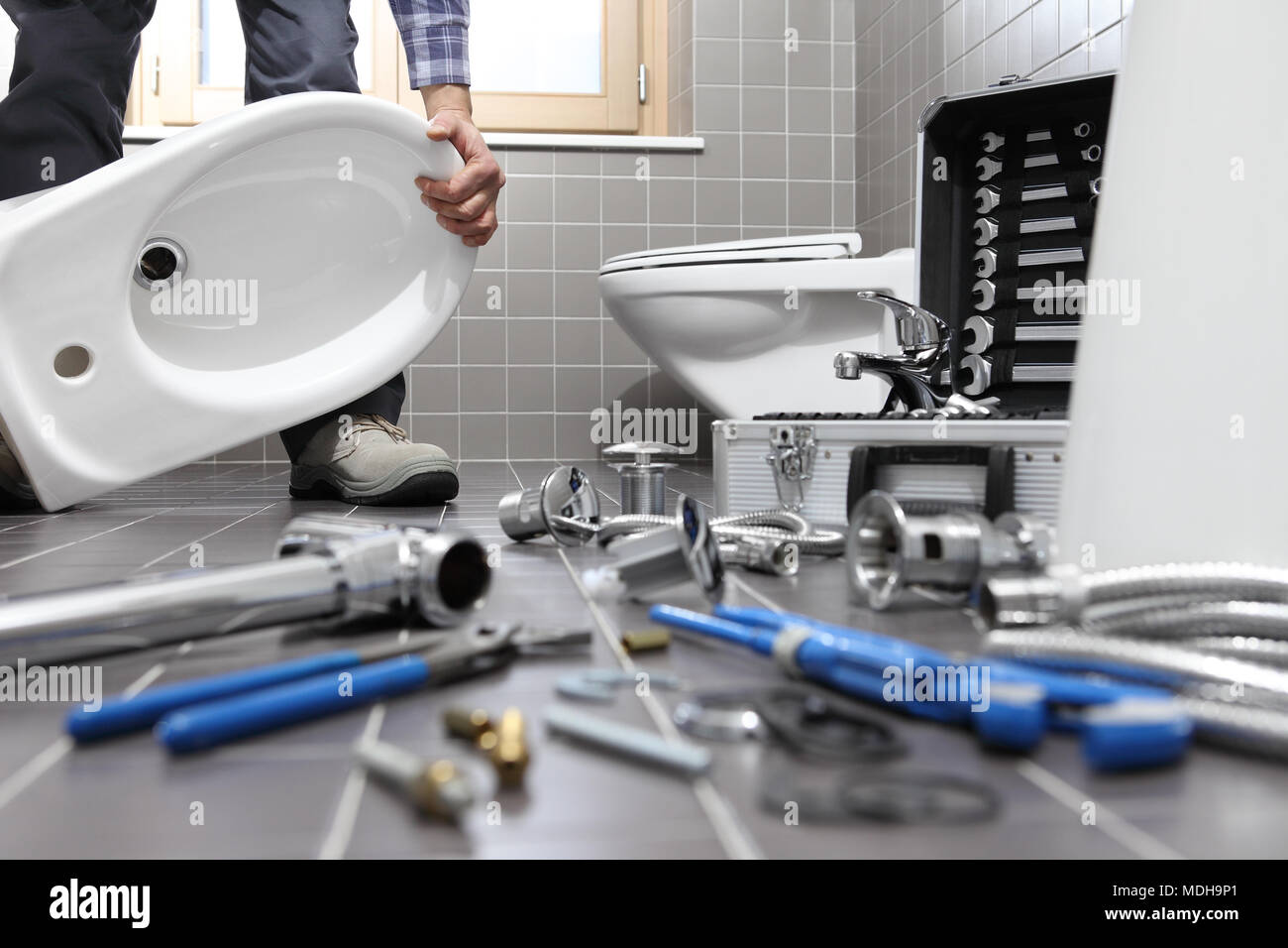 Plumber At Work In A Bathroom Plumbing Repair Service Assemble And - Bathroom repair services