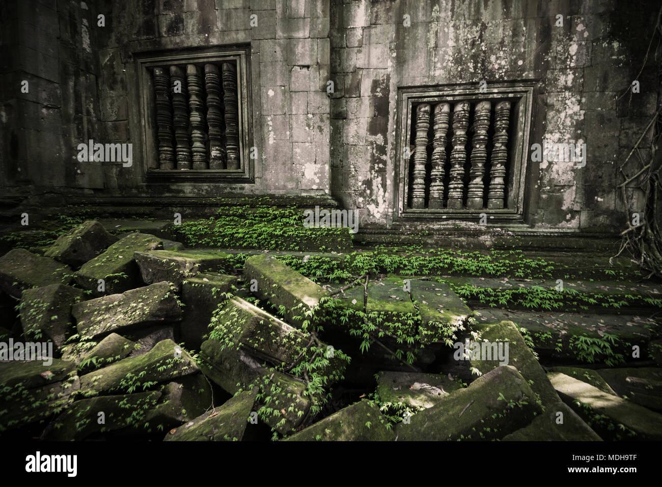 Balustraded windows at the ruins of Beng Meala; Siem Reap, Cambodia - Stock Image