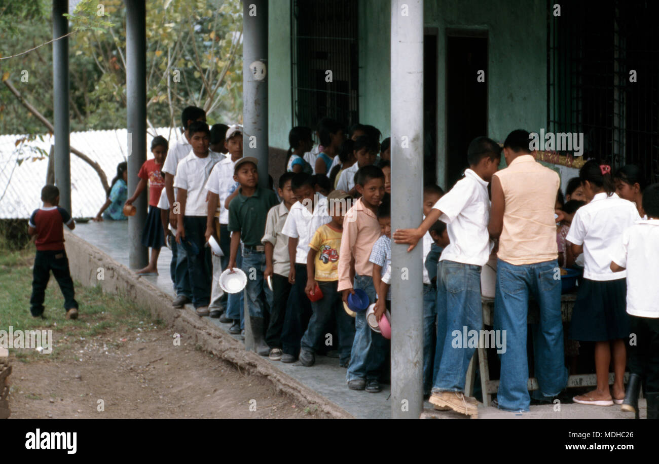 Indigenous chortí Maya school children are fed lunch at their school in La Pintada, western Honduras. - Stock Image