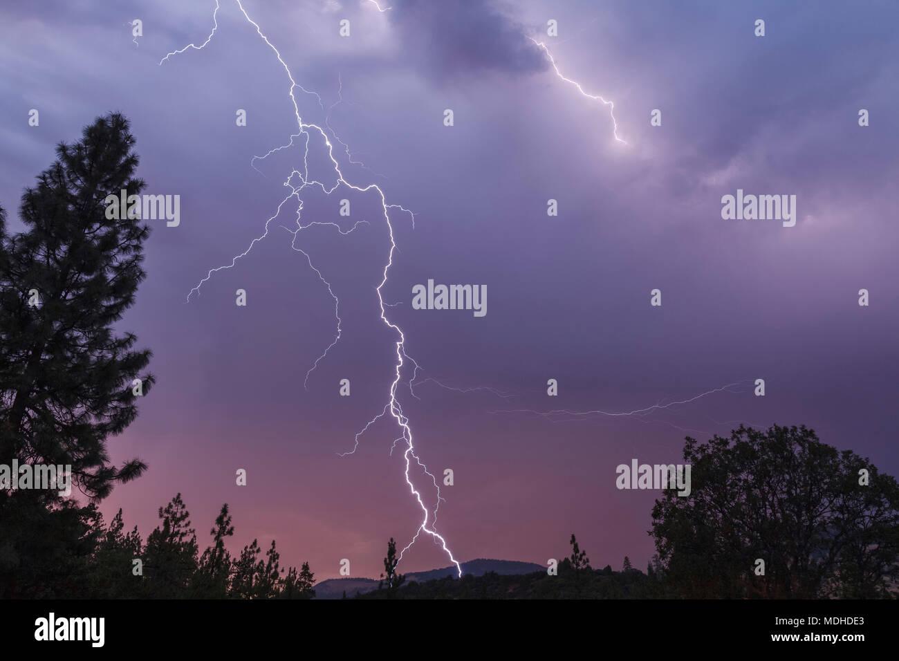 Lightning bolt strikes in this spectacular late evening image, Cascade Siskiyou National Monument; Ashland, Oregon, United States of America Stock Photo