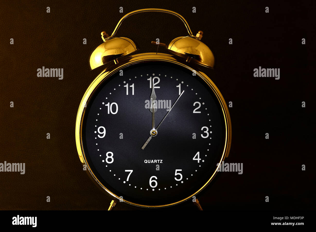 Old retro alarm clock with the hands set to 12:00 am or pm Stock